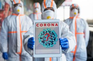 People with protective suits and respirators, coronavirus